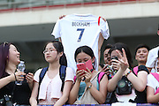 NANJING, CHINA - JUNE 18: (CHINA OUT) <br /> <br /> David Beckham Visits Jiangsu Sainty Football Club<br /> <br /> Fans cheer as David Beckham visits Jiangsu Sainty Football Club at Nanjing Olympic Sports Centre on June 18, 2013 in Nanjing, Jiangsu Province of China. <br /> ©Exclusivepix