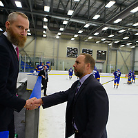 Todd Johnson, Head coach (4th Season) of the Regina Cougars men's hockey team shakes hands with UBC's head coach Sven Butenschön after the Men's Hockey Home Game on November 19 at Co-operators arena. Credit: Arthur Ward/Arthur Images