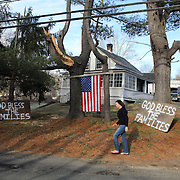 Signs and a USA flag outside a house near the Sandy Hook Elementary school in Sandy Hook after yesterday's shootings at Sandy Hook Elementary School, Newtown, Connecticut, USA. 15th December 2012. Photo Tim Clayton