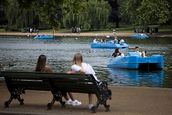 © Licensed to London News Pictures. 09/07/2021. Members of the public relax in boats on the Serpentine Lake in Hyde Park, central London on a summer's day. Wet and warm conditions are expected over the weekend. Photo credit: Ben Cawthra/LNP