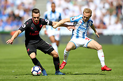 Arsenal's Aaron Ramsey (left) and Huddersfield Town's Alex Pritchard battle for the ball