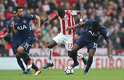 Stoke City's Badou Ndiaye and Tottenham Hotspur's Victor Wanyama battle for the ball