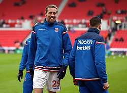 Stoke City's Peter Crouch warms up before during the Premier League match at the bet365 Stadium, Stoke.