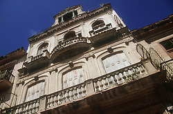 Architecture in Havana; Cuba showing building with ornate stone balustrade balcony,