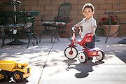 Nico playing with his tricycle in Nevada.