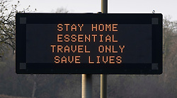 © Licensed to London News Pictures. 28/03/2020. Leatherhead, UK. A roadside matrix sign displays a message that says ' STAY HOME ESSENTIAL TRAVEL ONLY SAVE LIVES'  on the A24 near Leatherhead in Surrey. The Prime Minister Boris Johnson and Health Secretary Matt Hancock have tested positive for the virus and are now self isolating. Photo credit: Peter Macdiarmid/LNP