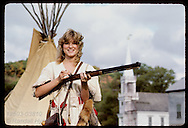 Tracey Rohlfing about to fire her rifle in a contest at annual Danl Boone Rendezvous;Boone home Missouri