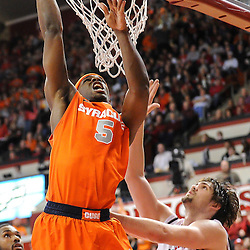 Syracuse Orange forward C.J. Fair (5) slam dunks a rebound over Rutgers Scarlet Knights forward Gilvydas Biruta (55) during first half NCAA Big East basketball action between #2 Syracuse and Rutgers at the Louis Brown Athletic Center. Syracuse leads 40-34 at halftime.