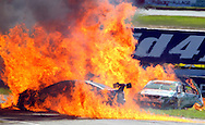 SPORT.Paul Kane.Getty Images.The race cars of Steve Owen and Karl Reindler are pictured on fire after a major crash on the start line in race 2 during the V8 Supercar round at Barbagallo Raceway on May 1, 2011.