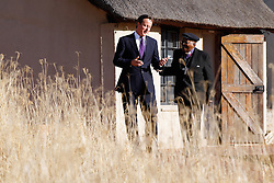 British Prime Minister David Cameron speaks with Bishop Desmond Tutu as he visits Liliesleaf in Johannesburg, South Africa, the home of the underground movement of the ANC resistance in the 1960's, as part of a two-day trade mission to Africa.