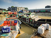 27 OCTOBER 2015 - YANGON, MYANMAR: Fishing trawlers at a pier in the market at Aungmingalar Jetty in Yangon. The market is home to one of the largest fish markets in Yangon and a meat and produce market.    PHOTO BY JACK KURTZ