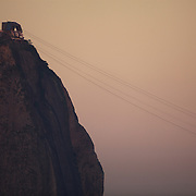 The cable cars head to and from the summit of Sugar Loaf Mountain, one of the iconic locations with breathtaking views of Rio de Janeiro, Brazil. 22nd July 2010. Photo Tim Clayton..