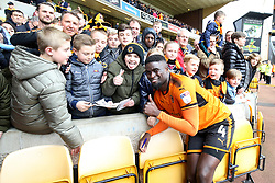 Wolverhampton Wanderers' Alfred N'Diaye poses for photos with young fans after the Sky Bet Championship match at Molineux, Wolverhampton.