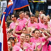 NLD/Amsterdam/20100807 - Boten tijdens de Canal Parade 2010 door de Amsterdamse grachten. De jaarlijkse boottocht sluit traditiegetrouw de Gay Pride af. Thema van de botenparade was dit jaar Celebrate, Ed Nijpels
