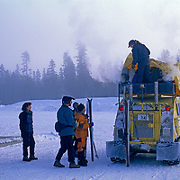 MONTANA, Yellowstone National Park. Snow coach picks up cross country skiers in West Yellowstone.