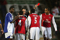 Photo: Paul Thomas.<br /> Blackburn Rovers v Arsenal. The Barclays Premiership. 13/01/2007.<br /> <br /> Referee Rob Styles (Black) sends off Gilberto Silva (R) for foul play on Blackburns Robbie Savage, while Blackburn's Aaron Mokoena (L) claps the decision.