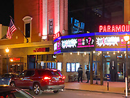 Huntington, New York, U.S. February 29., 2020.  Paramount theater facade has colorful bright signs and lights at night.