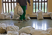 Collecting the weekly laundry in the communal room on A wing HMP & YOI Littlehey. Littlehey is a purpose build category C prison.