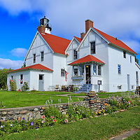 """""""Colors of Point Iroquois""""<br /> <br /> An amazing early fall day with flowers still in bloom along the beautiful walls surrounding Point Iroquois Light Station!!<br /> <br /> Lighthouses of the Great Lakes by Rachel Cohen."""