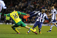WBA's Youssouf Mulumbu looks to go past Johan Elmander of Norwich city.  Barclays Premier league, West Bromwich Albion v Norwich city at the Hawthorns in West Bromwich, England on Sat 7th Dec 2013. pic by Andrew Orchard, Andrew Orchard sports photography.