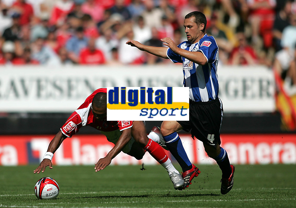 Photo: Lee Earle.<br /> Charlton Athletic v Sheffield Wednesday. Coca Cola Championship. 25/08/2007.Charlton's Marcus Bent (L) is caught by Wednesday's Kenny Lunt.