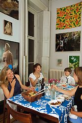 Left to right, Pamela Bell laughs with children Lenore Simotas, 16, Will Simotas, 11, and Anabel Simotas, 14, at their home in New York, N.Y., Sept. 15, 2011.