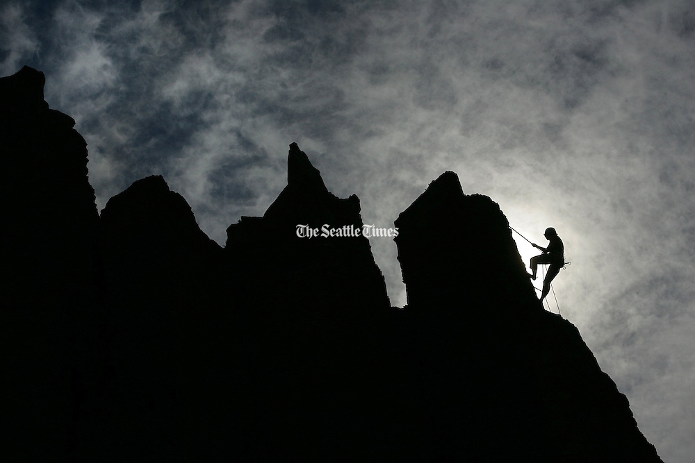 A climber ascends the rock columns at Frenchman's Coulee near Vantage, in Grant County, Washington.<br /> Mark Harrison / The Seattle Times