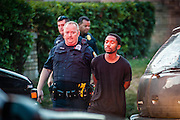 MILWAUKEE, WI -- 8/12/15 -- Police arrest a man at the scene of gun battle in Milwaukee's 7th police district. The 7th district is one of the most violent in the city.  Milwaukee leads the nation in most negative indicators of African-American social problems: educational achievement gaps, incarceration rates, unemployment and segregation. This year Milwaukee has already seen more than double the number of homicides than all of 2014…by André Chung #_AC13195