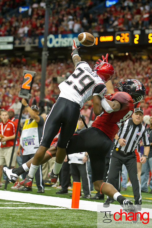 San Diego State's DB Larry Parker (29) attempts to break up a pass during the R+L Carriers New Orleans Bowl at the Mercedes-Benz Superdome.  Louisiana-Lafayette defeated San-Diego State 32-30. (Copyright Michael Chang)