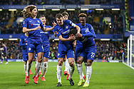 Chelsea Defender Cesar Azpilicueta protects Chelsea Midfielder Willian from a fliying missile object after his goal and celebrates with Chelsea Ethian Ampadu and Chelsea Midfielder Callum Hudson-Odoi during the The FA Cup fourth round match between Chelsea and Sheffield Wednesday at Stamford Bridge, London, England on 27 January 2019.