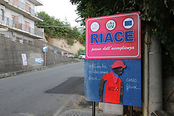 Italy, Riace  - October 2, 2018.Domenico Lucano, Mayor of Riace arrested for allegedly aiding illegal immigration..Riace's road sign reading: READING THE VILLAGE OF THE HOSPITALITY Tuesday October 2, 2018. (Credit Image: © Angilletta Albano/Ropi via ZUMA Press)