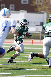 17 September 2011: Cameron Blossom carries to the left during an NCAA Division 3 football game between the Aurora Spartans and the Illinois Wesleyan Titans on Wilder Field inside Tucci Stadium in.Bloomington Illinois.
