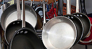 Pots and pans artistically hanging from kitchen ceiling. St Paul Minnesota USA