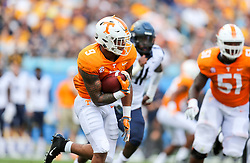Sep 1, 2018; Charlotte, NC, USA; Tennessee Volunteers running back Tim Jordan (9) runs the ball against the West Virginia Mountaineers during the second quarter at Bank of America Stadium. Mandatory Credit: Ben Queen-USA TODAY Sports