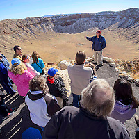 123113       Cable Hoover<br /> <br /> Tour guide Stephen Lang recounts the history of the Arizona meteor crater's discovery and verification to a tour group Tuesday at Meteor Crater.