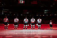 KELOWNA, BC - FEBRUARY 8: The starting line up for the Kelowna Rockets stands on the blue linen during the national anthem against the Portland Winterhawks at Prospera Place on February 8, 2020 in Kelowna, Canada. (Photo by Marissa Baecker/Shoot the Breeze)