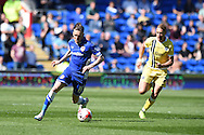 Craig Noone of Cardiff city (l) goes past Millwall's Lee Martin. Skybet football league championship, Cardiff city v Millwall at the Cardiff city stadium in Cardiff, South Wales on Saturday 18th April 2015<br /> pic by Andrew Orchard, Andrew Orchard sports photography.