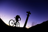 A mountain biker takes in the view during a ride of the Windy Ridge trail, Mount St. Helens N.V.M., Washington.