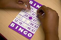 Child playing Bingo at nursery school