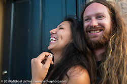 John Lyon of OH and Jacquelinee Provencio of SD on Sturgis' Main Street during the annual Black Hills Motorcycle Rally. SD, USA. August 8, 2014.  Photography ©2014 Michael Lichter., 2014.