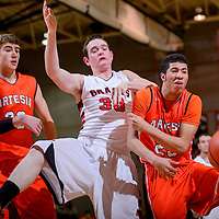 010815       Cable Hoover<br /> <br /> Grants Pirate Trace Burgoon (30) and Artesia Bulldog James Lawson (23) lose a rebound during the Gallup Boys Invitational at Gallup High School Thursday.