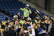 Police on horseback direct the Millwall fans during a pitch invasion after full time. Skybet football league one play off semi final 2nd leg match, Millwall v Bradford city at The New Den in London on Friday 20th May 2016.<br /> pic by John Patrick Fletcher, Andrew Orchard sports photography.