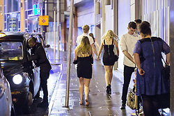 © Licensed to London News Pictures . 01/01/2015 . Manchester , UK . A woman walks barefoot along Withy Grove after clubs close down . Revellers usher in the New Year on a night out in Manchester City Centre .  Photo credit : Joel Goodman/LNP