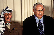 PLO leader Yasser Arafat with Israeli Prime Minister Benjamin Netanyahu at a White House news conference October 2, 1996 In Washington, DC.