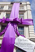 The London offices of royalist and establishment magazine The Lady, celebrates the forthcoming wedding between Prince William and his wife-to-be Kate Middleton. A giant purple ribbon has been draped across the width of the building in Bedford Street WC2 and a corner message tag tells the public of its best wishes for the happy couple.