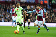 Fernandinho of Manchester city (l) goes past Carles Gill of Aston Villa.  Barclays Premier league match, Aston Villa v Manchester city at Villa Park in Birmingham, Midlands  on Sunday 8th November 2015.<br /> pic by  Andrew Orchard, Andrew Orchard sports photography.