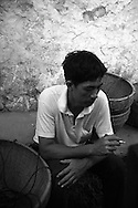 Black and white picture of a farmer smoking a cigarette while on a break, Yangshuo, Guanxi, China, Southeast Asia