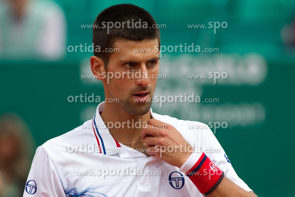 18.04.2012 Country Club, Monte Carlo, MON, ATP World Tour, Rolex Masters, 2. Runde, im Bild Novak Djokovic (SRB) in action during the second round match between Novak Djokovic (SRB) and Andreas Seppi (ITA) // at the Rolex Masters tennis tournament second Round of ATP World Tour at Country Club, Monte Carlo, Monaco on 2012/04/17. EXPA Pictures © 2012, PhotoCredit: EXPA/ Mitchell Gunn