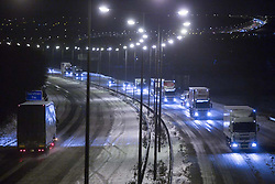 © Licensed to London News Pictures . 26/01/2013 . Wigan , UK . View of the M6 at Junction 26 this morning (26th January 2013) . Drivers have been stranded in cars overnight on the M6 near Wigan after the motorway was closed following heavy snow . Photo credit : Joel Goodman/LNP