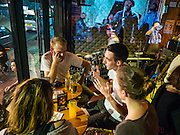 28 JANUARY 2016 - BANGKOK, THAILAND:  German tourists in SoulBar, a popular bar on Chareon Krung Road in the Chinatown section of Bangkok.       PHOTO BY JACK KURTZ